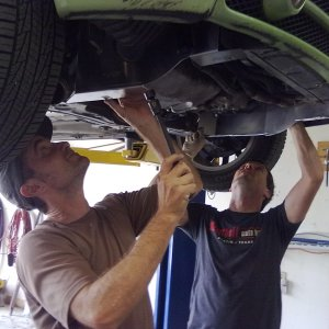 Jim and Robby installing a Panzer plate on a Beetle
